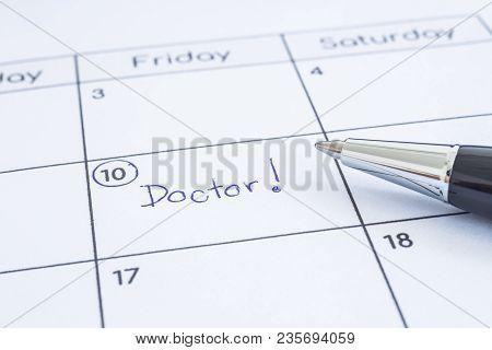 Closeup The Blue Worddoctor Written On Timetable With Circle Mark. Modern Pen Put On Calendar Sheet