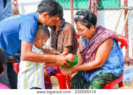Phetchabun-thailand, April 14,2013-thai Culture On Songkran Day With A Man Kindly Watering On Hand O