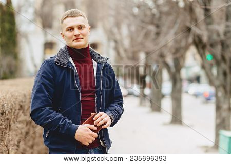 Guy In Jacket Stands In Middle Of Alley