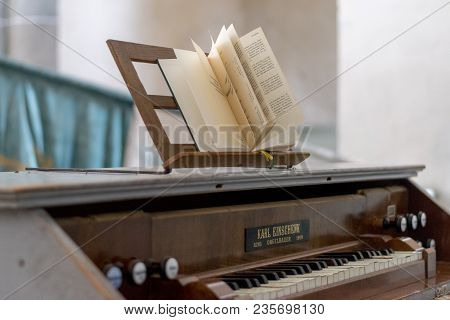 Carta, Romania - 13 August, 2017: A Music Book With Songs And Musical Notes Nearby A Piano.