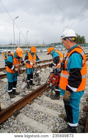 Tobolsk, Russia - July 13. 2016: Sibur Company Railway Workers Repairing Way
