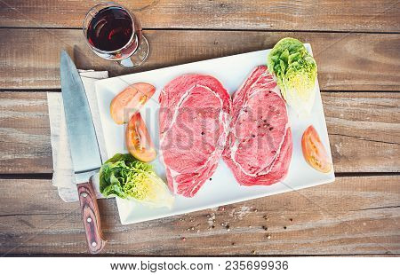 Raw Beef Steaks With Vegetables, Salt And Spices Top View