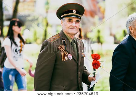 Vichuga, Russia - May 9, 2016: A Veteran Of World War Ii On The Victory Day Parade In Russia. The Ma