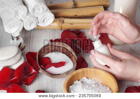 Spa Procedures For Hands With Petals Of Red Roses And Accessories, Applying A Skin Softening Lotion.