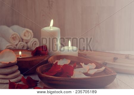 Romantic Atmosphere Before The Spa Treatments With Burning Candles, Rose Petals And A Light Haze Of