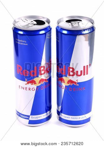Novyy Urengoy, Russia - April 4, 2018: Two Opened Aluminium Cans Of The Red Bull Energy Drink Isolat