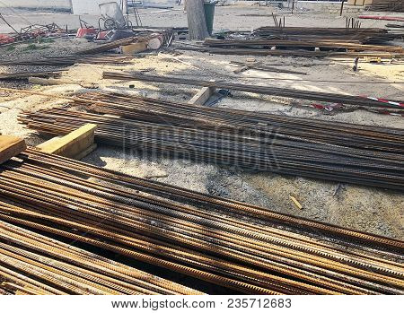 Metal, Iron Reinforcement Lying On The Ground On The Construction Site. Material For Repairs In An A