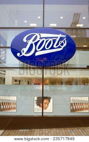 Bracknell, England - April 12, 2018: Window Display And Company Name Of The Boots Retail Store And P