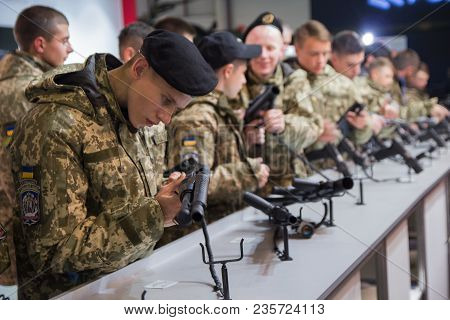 Kiev, Ukraine - October 11, 2017: Cadets Of The Military School Study Weapons At The Arms Exhibition