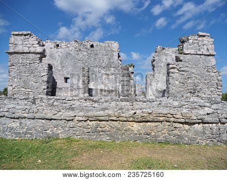 Ancient Ruins Of Stony Historical Building With Windows At Tulum Mayan City In Mexico, Large Archaeo