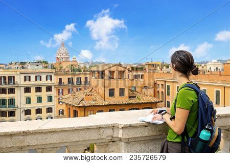 Tourist Looks At The Horizon On The Landscape Of The City Of Rome, Italy. From The Top Of The Trinit