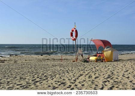 Lifeguard Lwatchtower On A Deserted Beach On A Summer Day With Calm Sea And Blue Sky