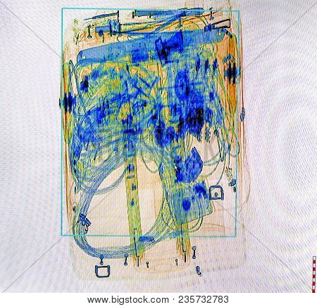 X-ray Screenshot Of An Trolley Bag Full Of Cable And Electronics.