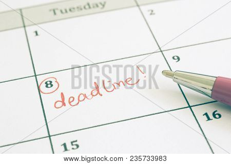 Closeup Planner Calendar And Pen, Vintage Tone. Focus On The Red Worddeadline Written On Timetable