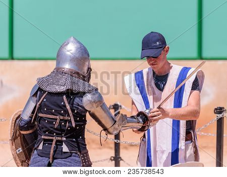 Goren, Israel, April 06, 2018 : A Squire Helps A Knight To Wear Armor At A Knight Festival In Goren