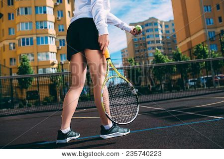 Tennis Player Woman In Skirt Holding Racket Wearing Short Skirt Outfit And Running Shoes. Concept Of