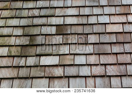 Wood Shingle Tiles On A Roof For Background