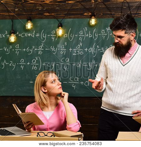 College And Education Concept. Girl Student Listening Bearded Teacher, Lecturer, Professor. Student,