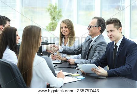 Handshake Of Business Partners At The Negotiating Table In The Office