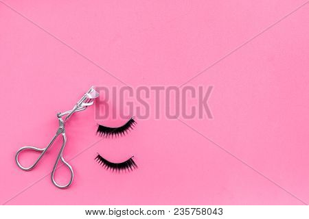 Curled And Thick Eyelashes. False Eyelashes And Eyelash Curler On Pink Background Top View.