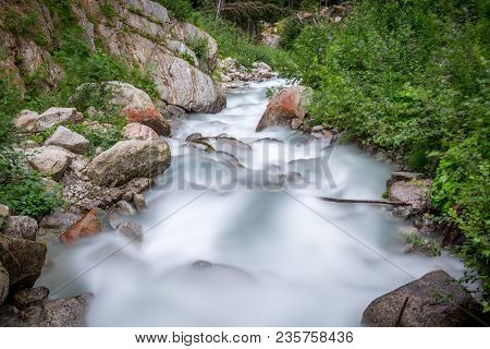 Long Exposure Of A Torrent In The French Alps Near Chamonix Mont Blanc And The Italian Border.