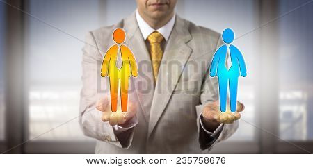 Unrecognizable Recruitment Agent Is Comparing Two Male Candidate Icons In The Open Palms Of His Hand