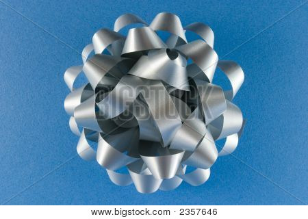 Silver Gift Bow On A Blue Background