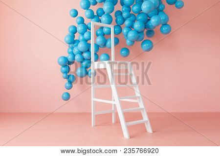 Pink Bright Studio Interior With White Ladder And Hanging Blue Balls. Copy Space And Nobody.