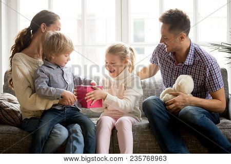 Sister Presenting Gift For Little Brother Giving Cute Boy Box With Present, Excited Kid Girl Making