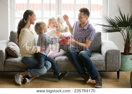 Happy Family With Kids Congratulate Excited Dad With Fathers Day, Wife With Little Son And Daughter