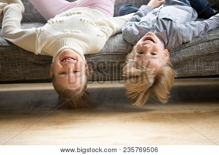 Portrait Of Boy And Girl Laughing Lying Upside Down, Happy Cheerful Kids Brother With Sister Having