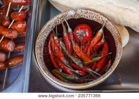 Marinated Hot Peppers In Ceramic Bowl. Pickled Chili Peppers