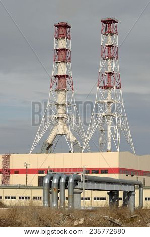 Chimney At The Thermal Power Plant.combustion Products Are Discharged From The Pipe Into The Atmosph