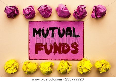 Word writing text Mutual Funds. Business concept for Investment Strategy to purchase shares with other investors written Pink Sticky Note Paper the plain background Paper Balls. poster