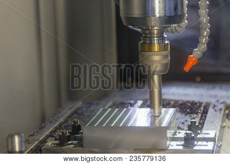 The Cnc Milling Machine Cutting The Mold Part With Indexable Radius Endmill Tool.