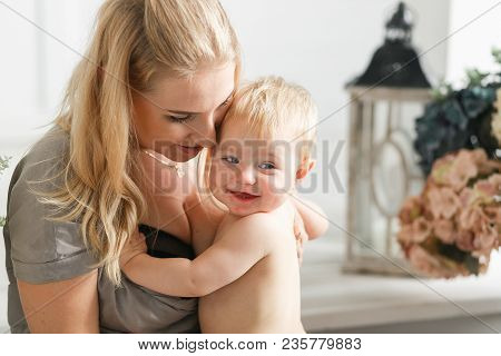 Portrait Of Happy Laughing Baby Hugging With Cheerful Young Smiling Mother. Scene Of Pure Love And H