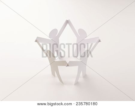 Closed Joining Of Four Paper Figure With Gray One In Hand Up Posture On Bright White Background. In