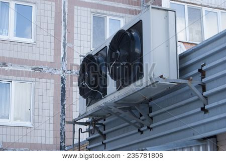 Two Large Black Industrial Fans From The Air Conditioner On The Wall Of The Store