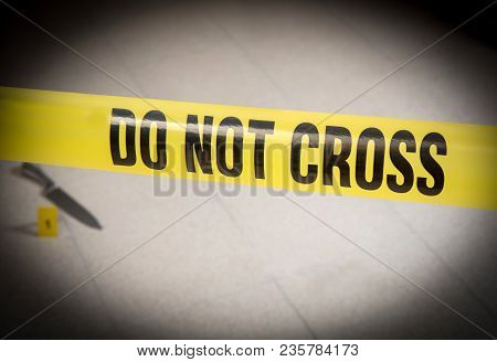 A Crime Scene With The Yellow Tape