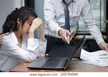 Stressed Depressed Young Asian Business Woman Are Being Blamed With Boss In Workplace Of Office.