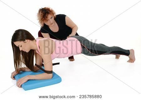 Chaturanga Dandasana -four-limbed Staff Pose Variation With Yoga Props - (belt Or Block)  A Young Wh