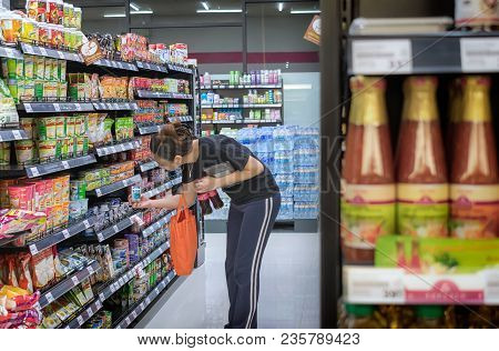 Bangkok, Thailand - October 30: An Unidentified Shopper Shops In The Aisle Of Maxvalu Supermarket In