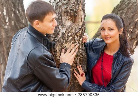 Lovely Romantic Outdoor Embracing Pair Of Man And Woman Enjoying Best Weather In Natural Golden Seas