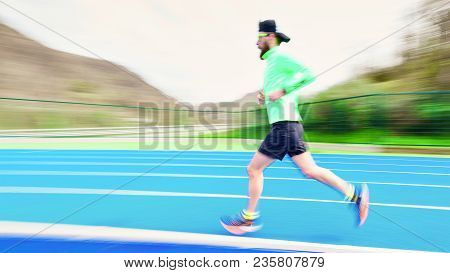 Photography Deliberately Moved By Runner Trains On The Athletics Track.