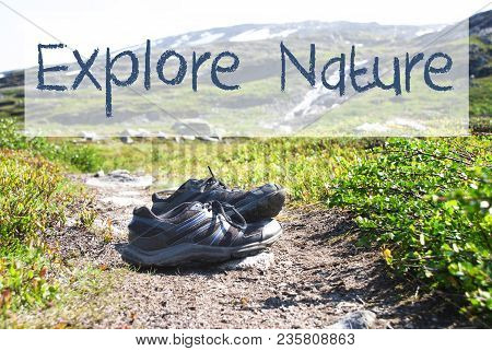 English Text Explore Nature. Trekking Shoes On Hiking Path In Norway. Mountains In The Background