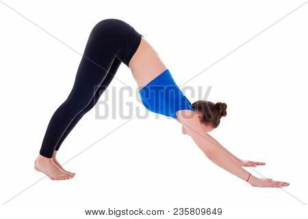 Young Woman In Yoga Pose Isolated On White Background