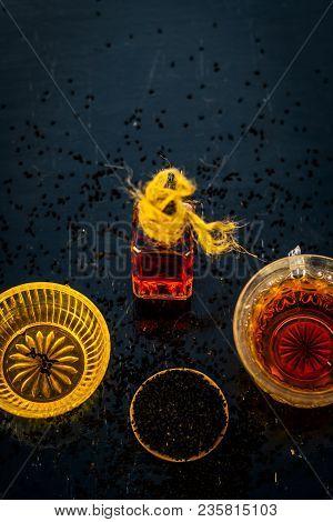 Close Up Of Ayurvedic Treatment Consisting Of Kalonji, Roman Coriander With Honey, Black Tea And Its