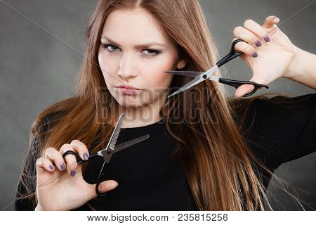 Professional Elegant Female Barber With Scissors.