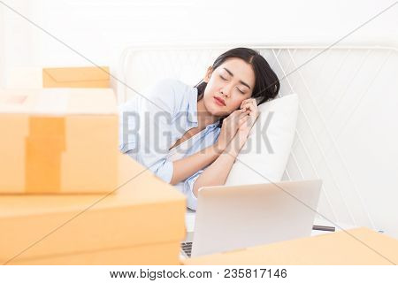 Young Asian Woman Sleep While Working At Home, Young Owner Woman Start Up For Business Online. Peopl