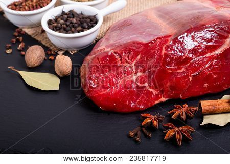 Food Concept Picece Of Shank Beef On Black Slate Stone And Various Spice With Copy Space